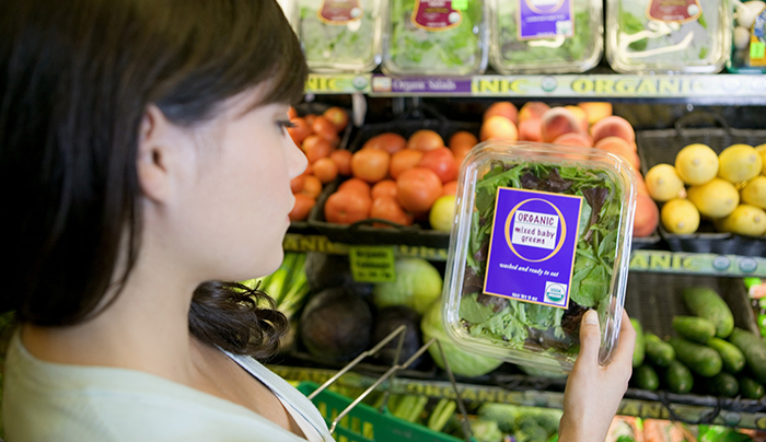 consumer(s) picking up produce at farm stand or grocery store