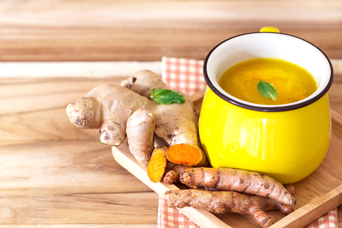 cup of turmeric tea with lemon and ginger
