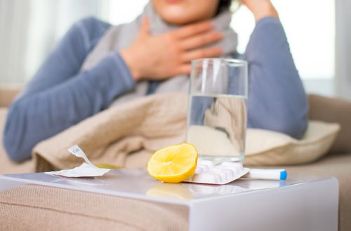 sick woman with water and lemon