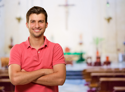 Portrait Of Happy A Man Standing In Church