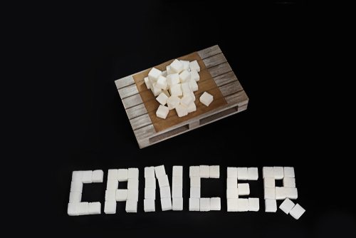 cancer spelled out with sugar cubes