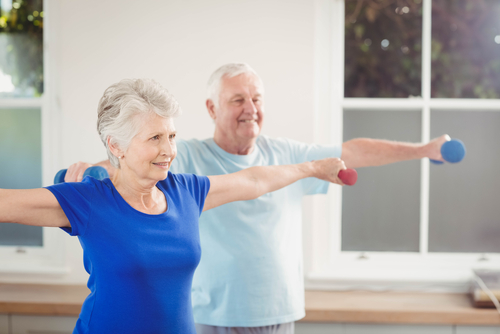 senior couple performing stretch exercises