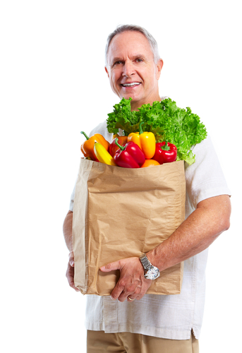 senior man with bag of groceries
