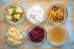 serving bowls with various fermented foods