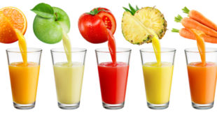 Fresh juice pours from fruit and vegetables