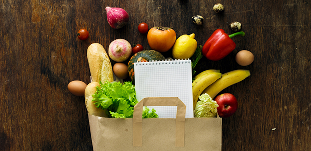 grocery bag with produce and list
