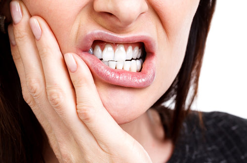 focus on mouth with tooth pain