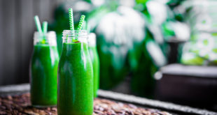 fresh green smoothies on counter