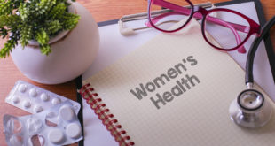 Stethoscope on note book with Women's Health words