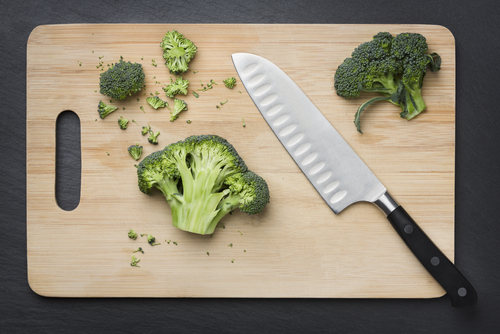 cut broccoli with knife