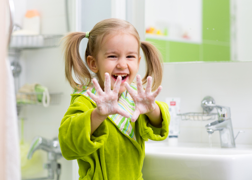 child showing soapy palms