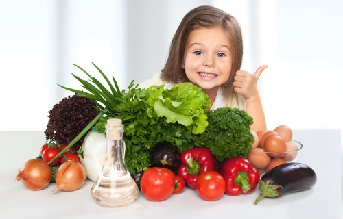 girl giving health foods thumbs up