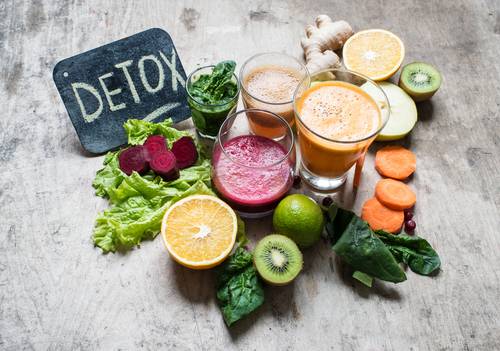 variety of juices and produce for detox